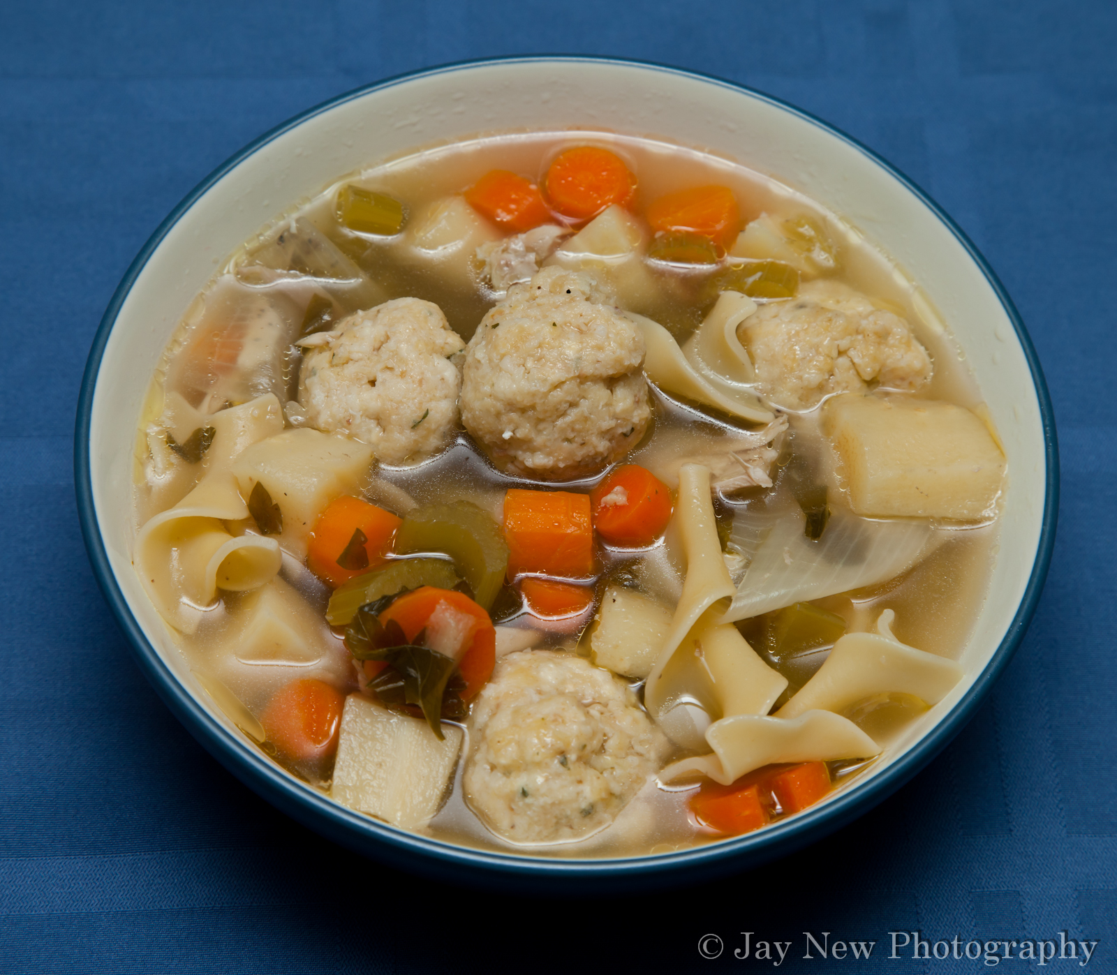 home made chicken noodle soup with matzo balls